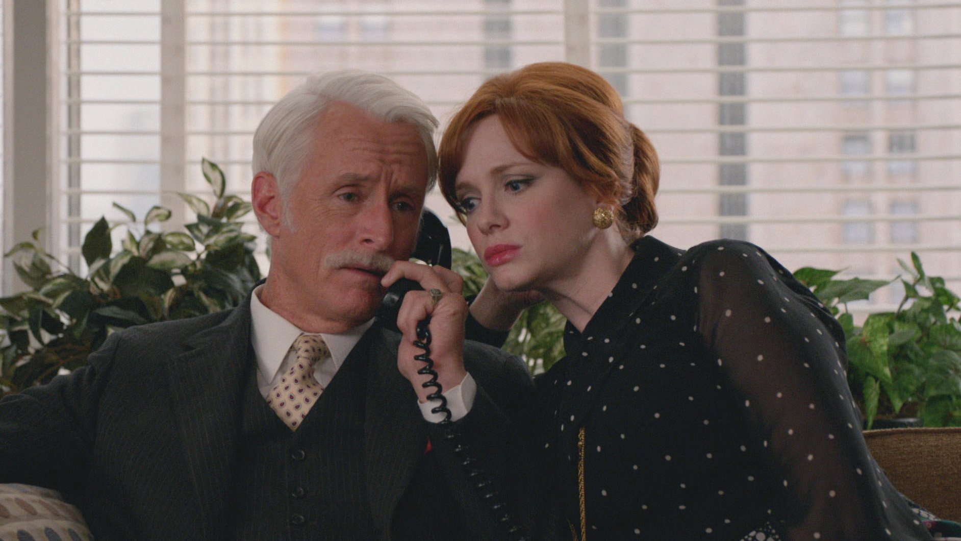 John Slattery as Roger Sterling and Christina Hendricks as Joan Harris - Mad Men _ Season 7B, Episode 11 - Photo Credit: Courtesy of AMC
