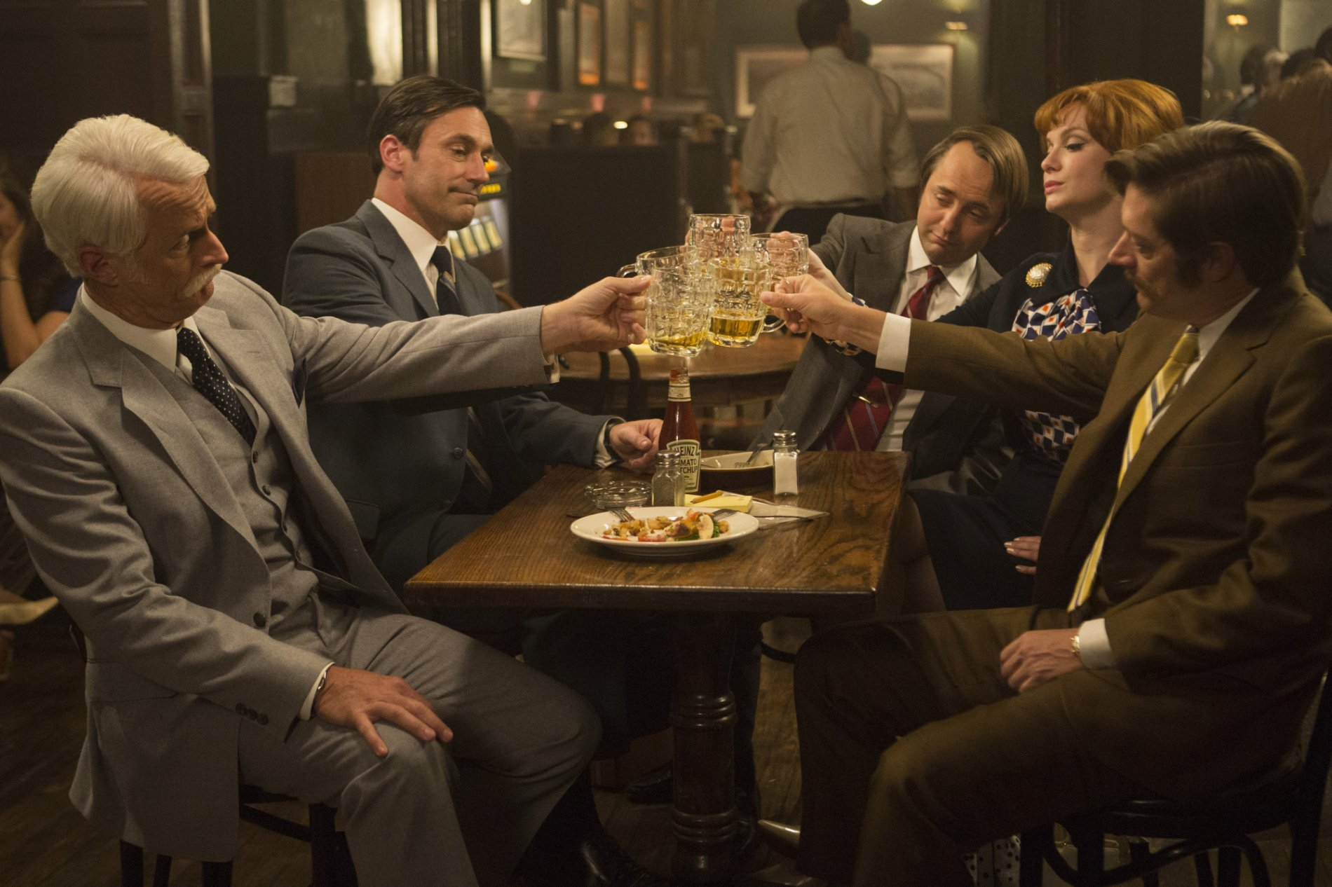 John Slattery as Roger Sterling, Jon Hamm as Don Draper, Vincent Kartheiser as Pete Campbell, Christina Hendricks as Joan Harris and Kevin Rahm as Ted Chaough - Mad Men _ Season 7B, Episode 11 - Photo Credit: Justin Mintz/AMC