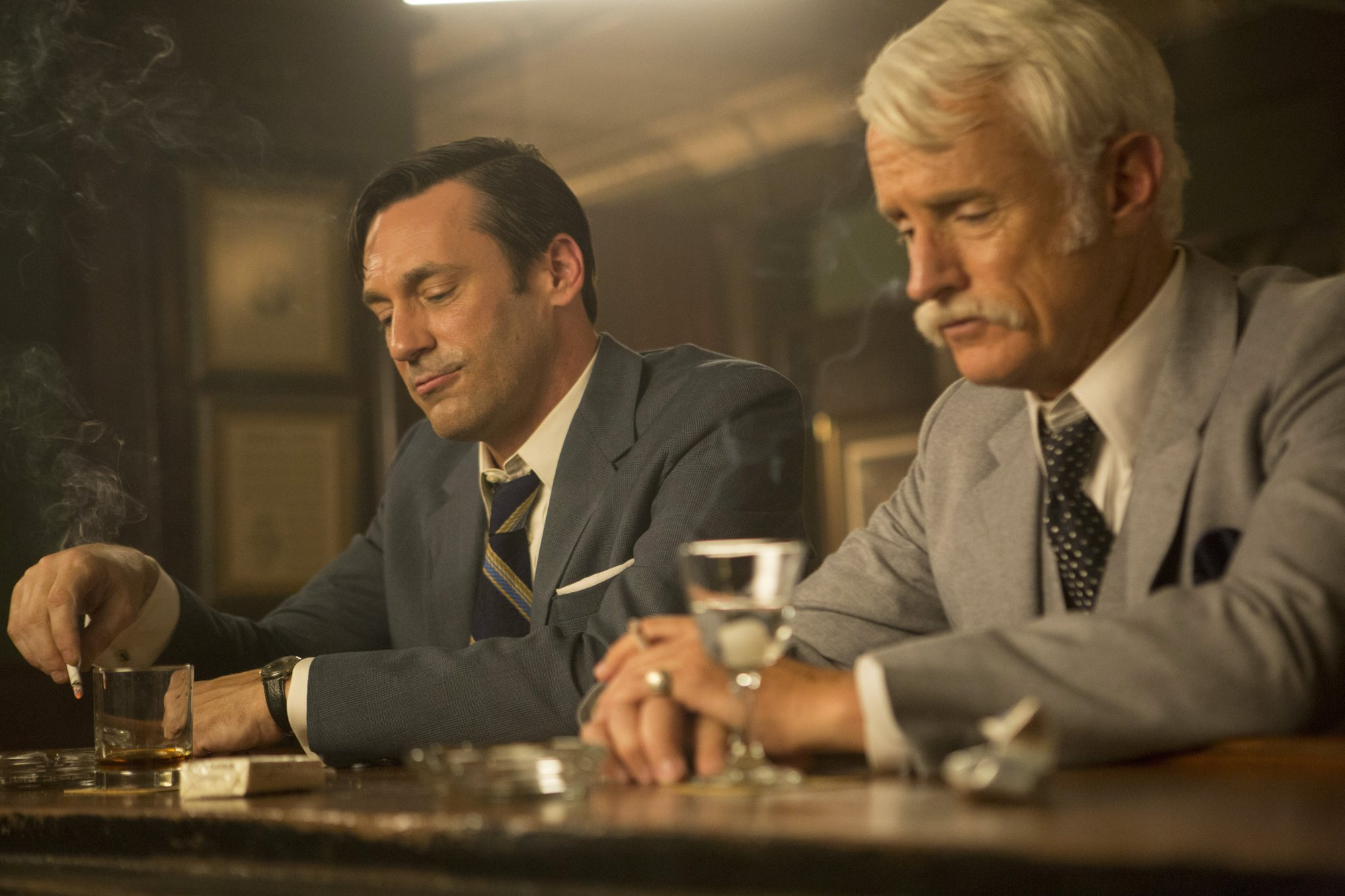 Jon Hamm as Don Draper and John Slattery as Roger Sterling - Mad Men _ Season 7B, Episode 11 - Photo Credit: Justin Mintz/AMC