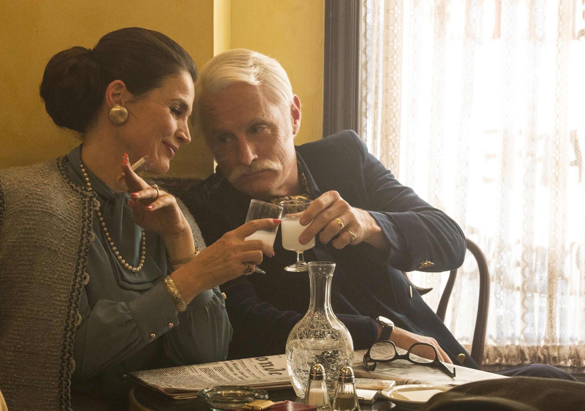 Julia Ormond as Marie Calvet and John Slattery as Roger Sterling - Mad Men _ Season 7B, Episode 14 - Photo Credit: Michael Yarish/AMC